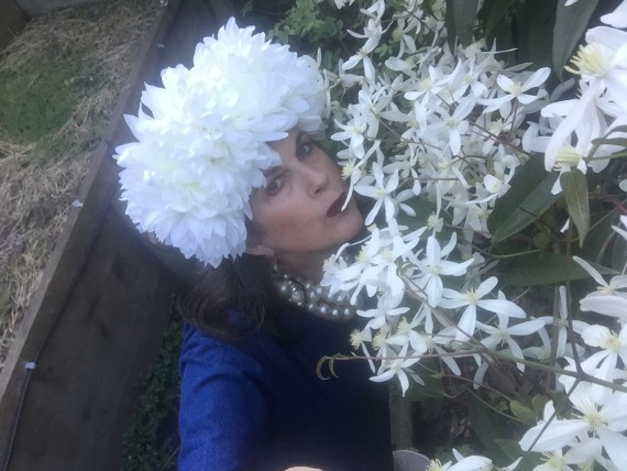 Contessa smelling the Clematis